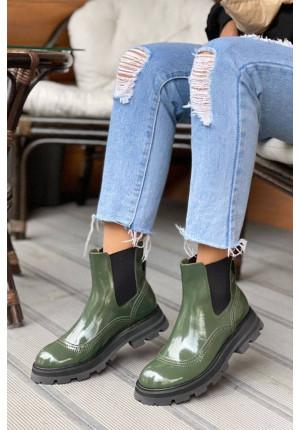 Кожаные зелёные ботинки